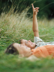 Boy and girl lying on the grass