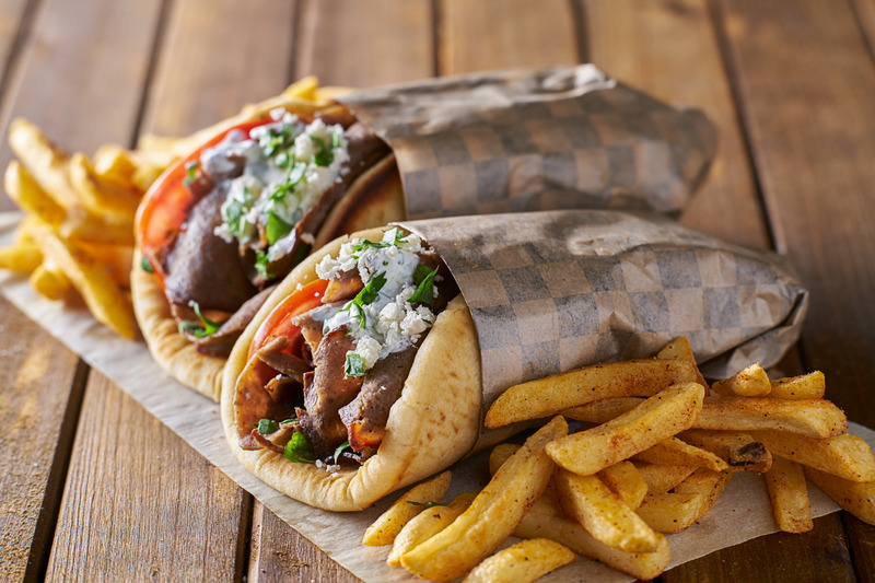 tasty greek gyros with fries with feta cheese and tzattziki sauce - get greek, italian, seafood, sushi, thia and modern australian food delivered in the sutherland shire