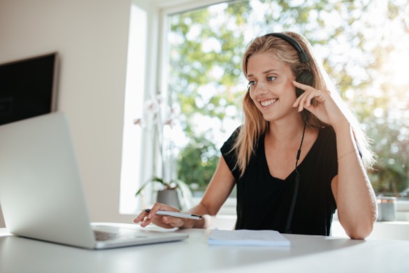 woman listening to headphones at computer
