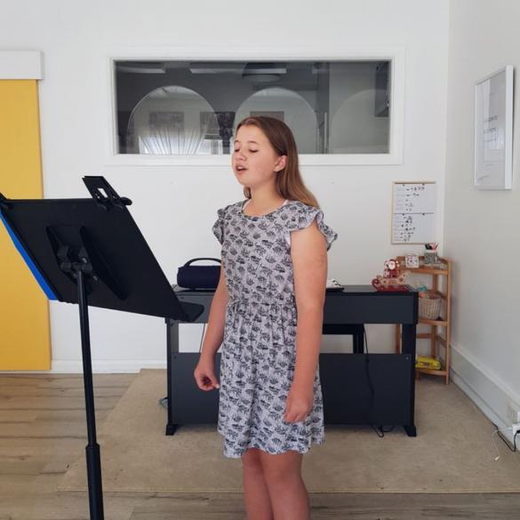 Young girl singing at Sutherland Shire Singing