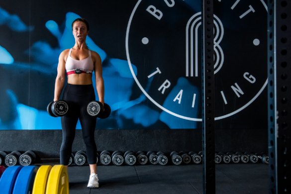 Body Fit Training room with woman lifting weights