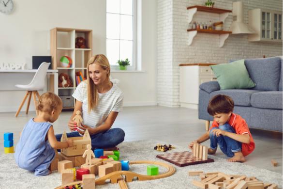 mum playing blocks with children