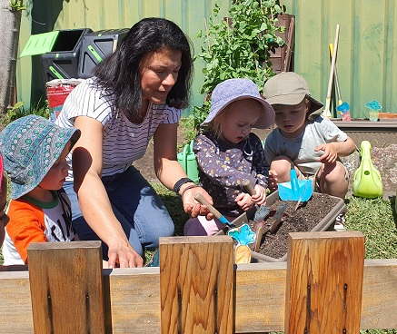 Sutherland Shire Childrens Services Family Day Care Worker Magda in the garden with kids