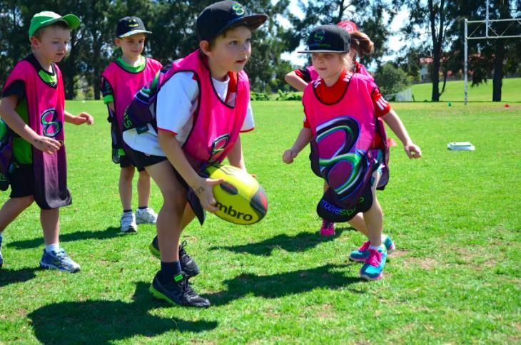 kids playing football at Motiv8sports