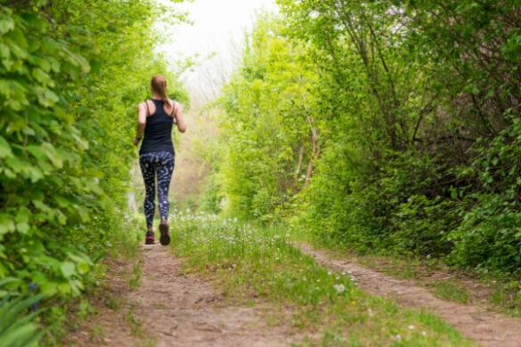 woman jogging through bush