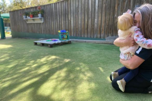 childrens serviceschildcare worker hugging child