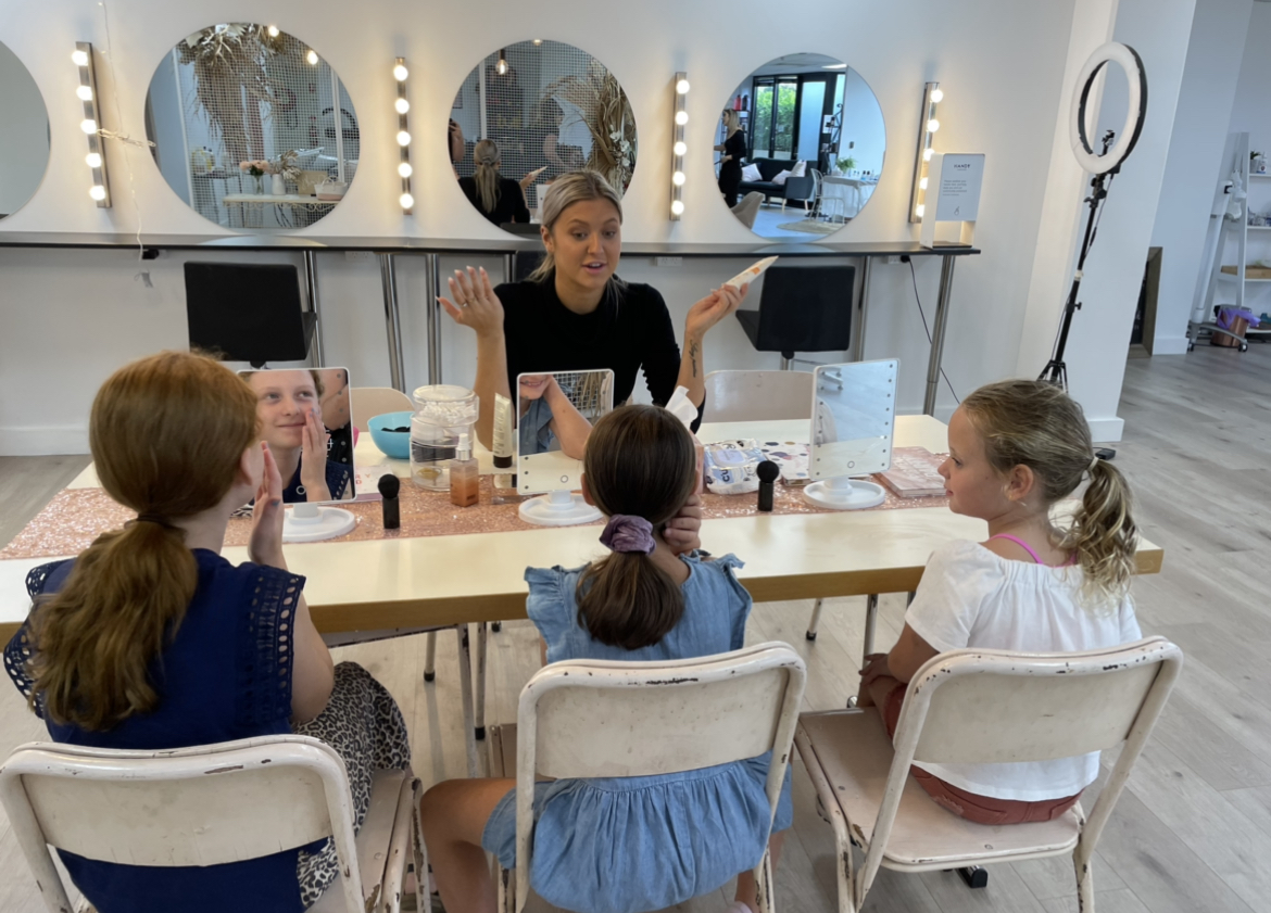 The Bridal Bar Kids Workshop, beautician showing kids how to use makeup